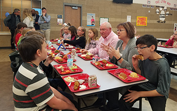 Secretary Perdue and SNA President Gay Anderson Enjoy School Lunch with Students